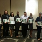 Photo of 7 representatives from Florida Commuter Services programs that receiving certificates recognizing their support and assistance to Best Workplaces for Commuters
